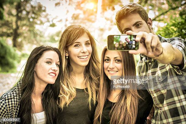 group of friends having fun with smartphone - pjphoto69 stock pictures, royalty-free photos & images