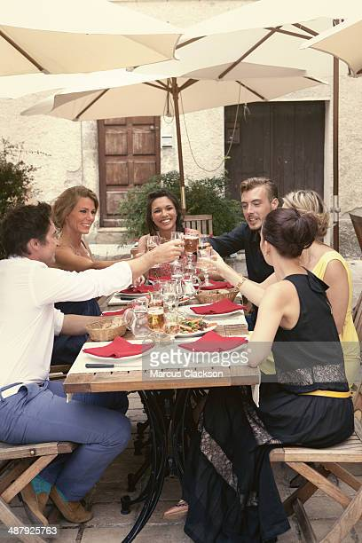 Group of friends having lunch in Provence.