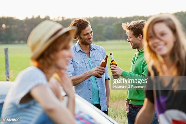 Group of friends having outdoor party