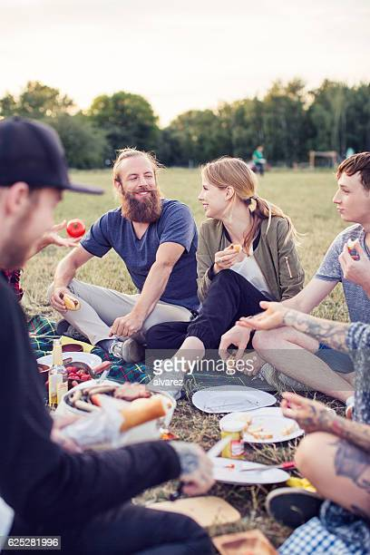 Group of friends having picnic in a park