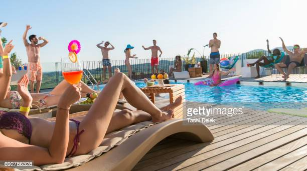 group of friends having pool party - pool party stock pictures, royalty-free photos & images