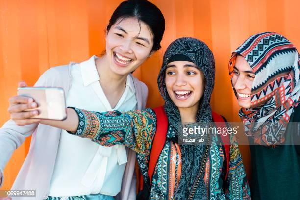 Group of friends having selfie.