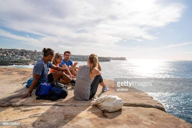 group of friends hiking and taking a break - eco tourism stock pictures, royalty-free photos & images