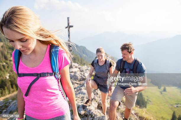 Group of friends hiking in mountain landscape