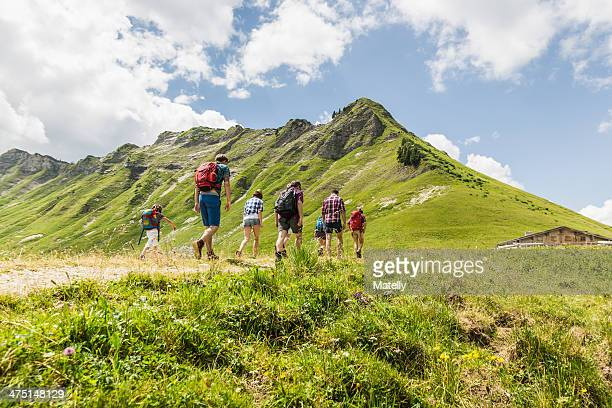 group of friends hiking, tyrol, austria - medium group of people stock pictures, royalty-free photos & images