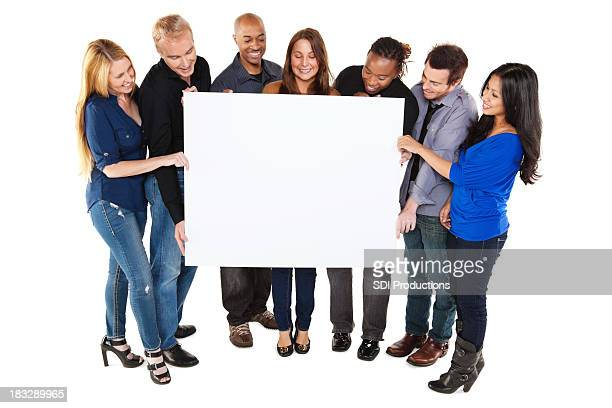 group of friends holding and looking at blank sign - blank sign stock photos and pictures