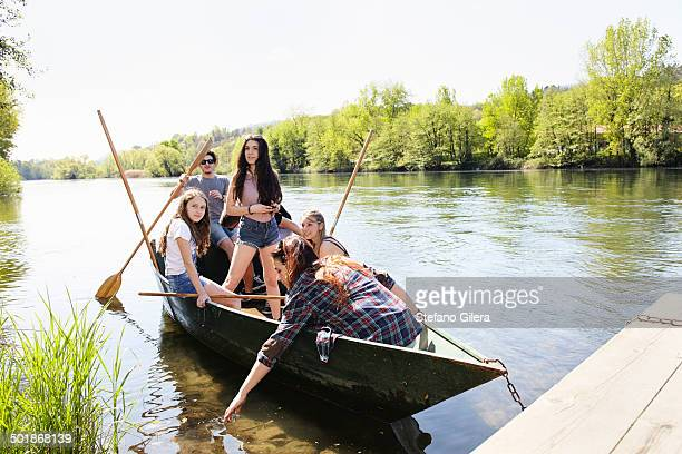 Group of friends in a row boat