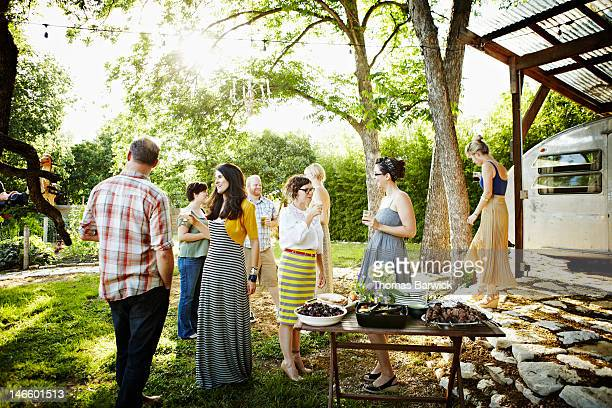 Group of friends in backyard waiting to eat