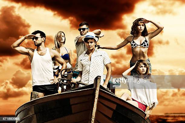 group of friends in boat - female pirate stock photos and pictures