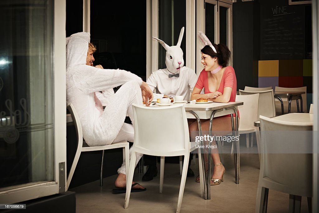 Group of friends (all dressed as bunny) in cafe : Stock Photo