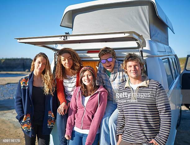 Group of friends in camper van.