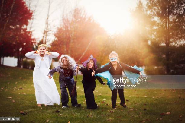 group of friends in halloween costumes - zombie girl stock photos and pictures
