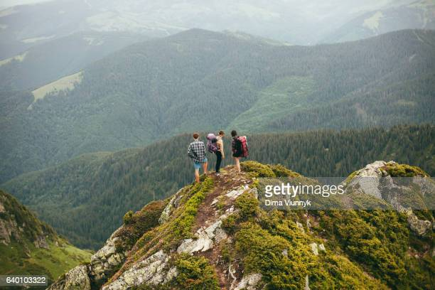 group of friends in mountains - eco tourism stock pictures, royalty-free photos & images