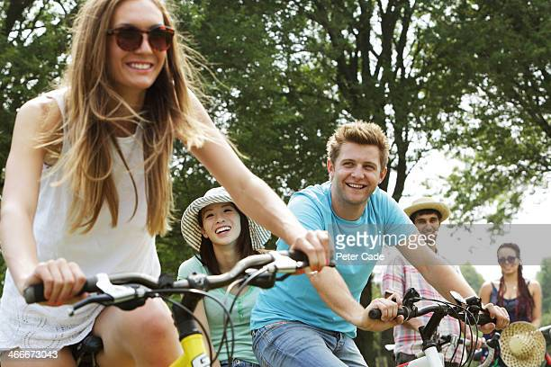 Group of friends in park on bikes