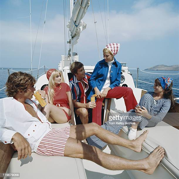 Group of friends in sailing boat