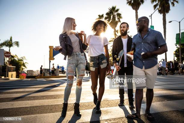 group of friends in santa monica - los angeles - have fun during a vacation - santa monica stock pictures, royalty-free photos & images