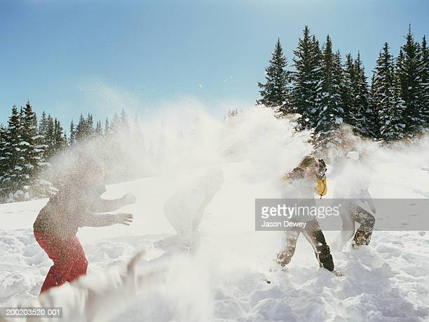 group of friends in snowball fight in mountains - apres ski stock pictures, royalty-free photos & images