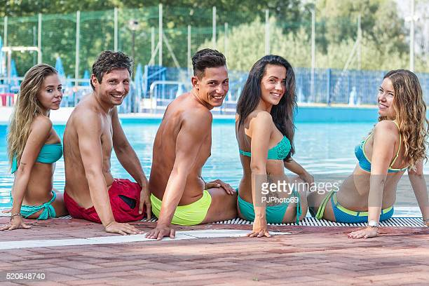 group of friends in swimming pool - pjphoto69 stock pictures, royalty-free photos & images
