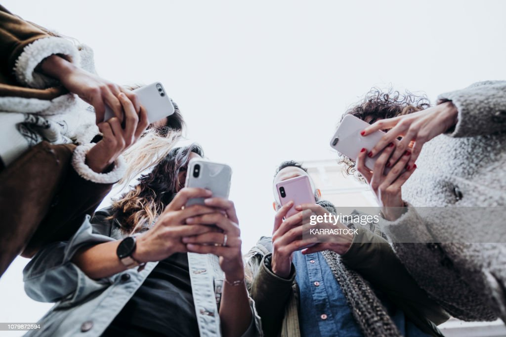 Group of friends in the street with smartphone : Foto de stock