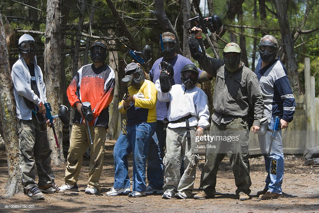 Group of friends including children (9-14) with paintball gear, portrait : Foto stock