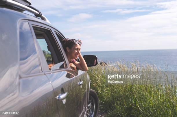 group of friends inside car at viewpoint off oregon coast - oregon coast stock pictures, royalty-free photos & images