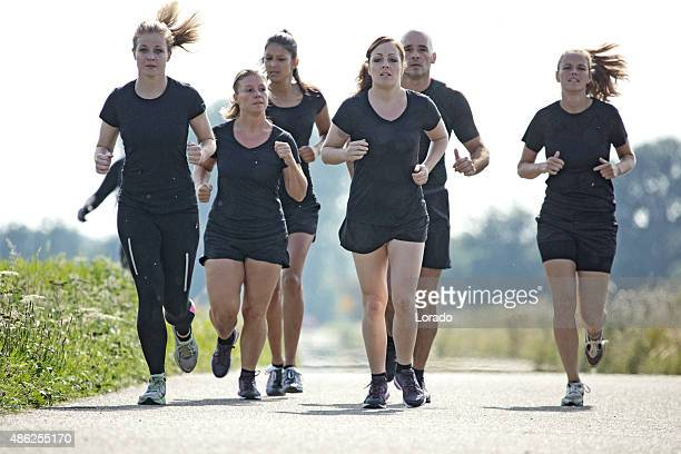 group of friends jogging outdoors