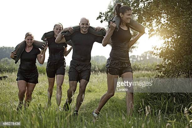 group of friends jogging with the weights outdoors