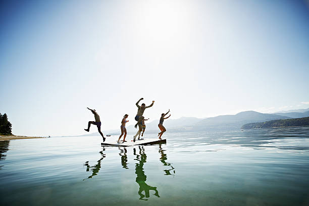 Group Of Friends Jumping Off Floating Dock Wall Art