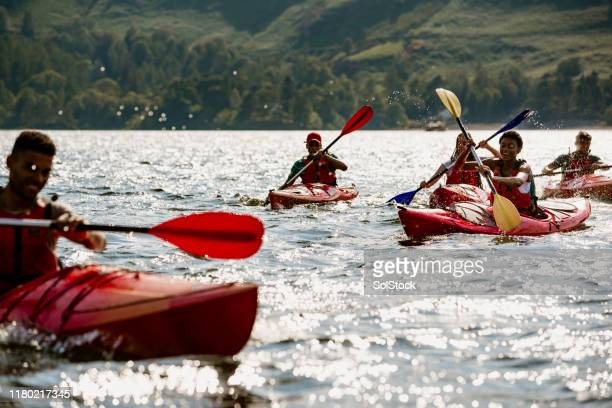 group of friends kayaking - cumbria stock pictures, royalty-free photos & images