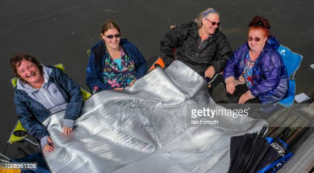 A group of friends keep warm at the start of the 30th Sunderland International Air show on July 28 2018 in Sunderland England Held over three days on...
