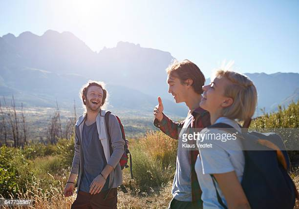 Group of friends laughing on hiking trip