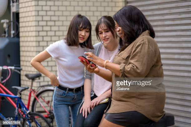 Group of friends looking at a smartphone