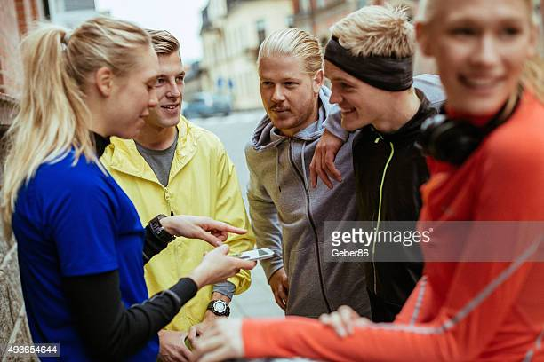 Group of friends looking at mobile phone