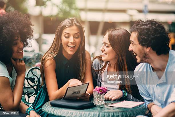 Group of friends looking at the menu