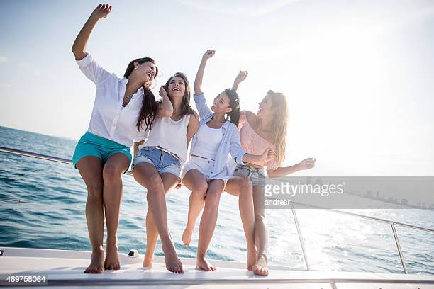 Group of friends looking happy on a yacht