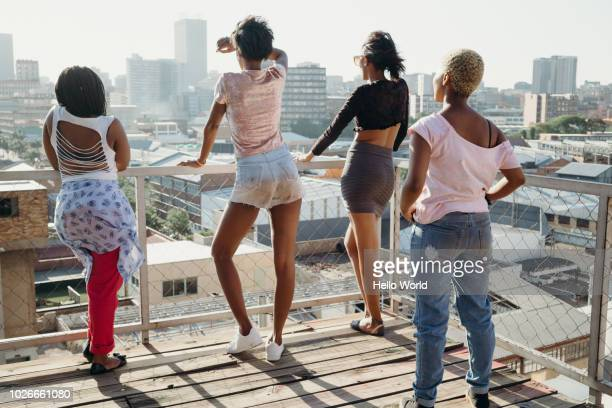 Group of friends looking out at city view