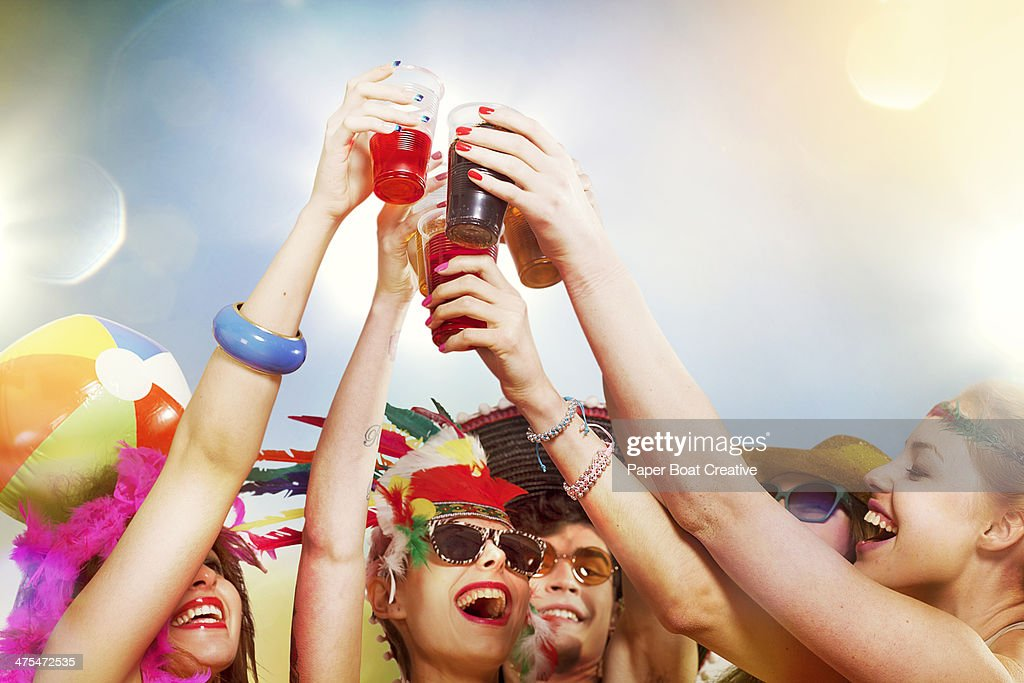 Group of friends making cheers salute with drinks : Stock Photo