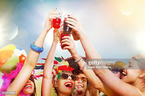 group of friends making cheers salute with drinks - music festival stock pictures, royalty-free photos & images