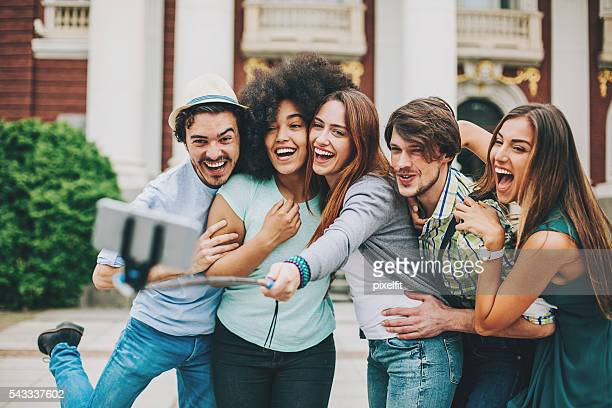 Group of friends making funny selfie