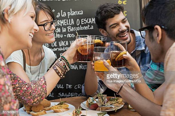 group of friends making toast in tapas bar - tapas stock photos and pictures