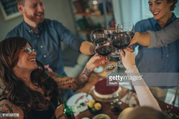 Group of friends making toast with wine glasses