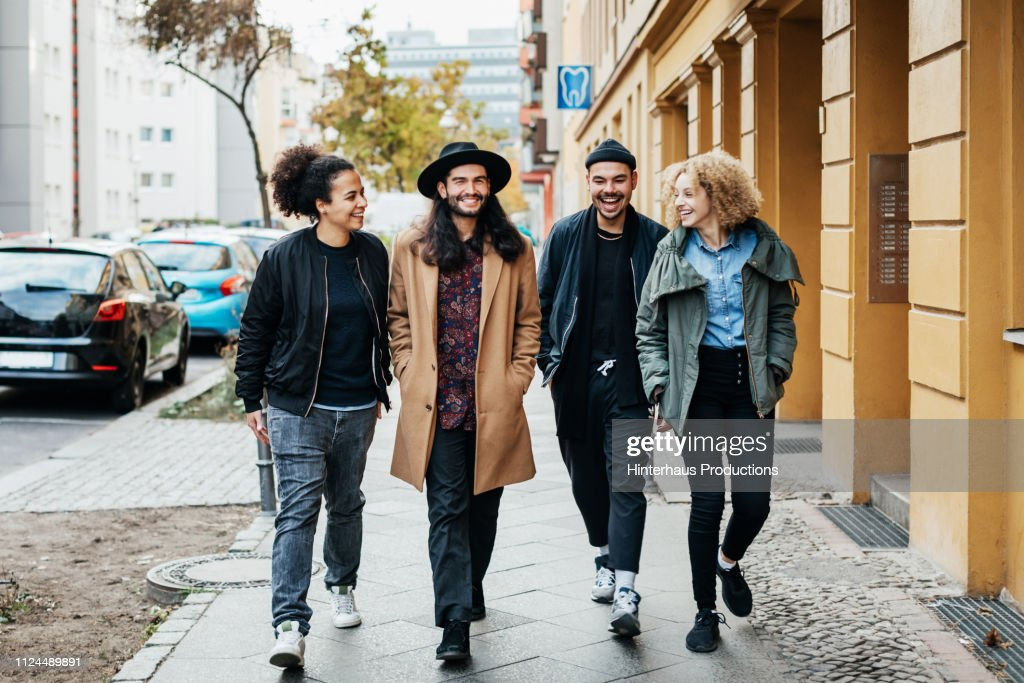 Group Of Friends Making Way To A Bar : Stock Photo