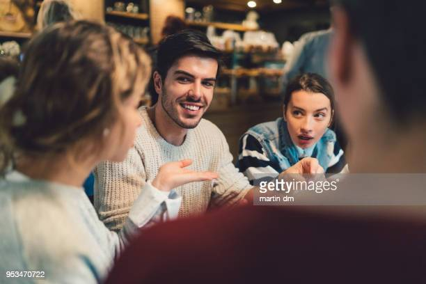 group of friends meeting in cafe - clique stock photos and pictures