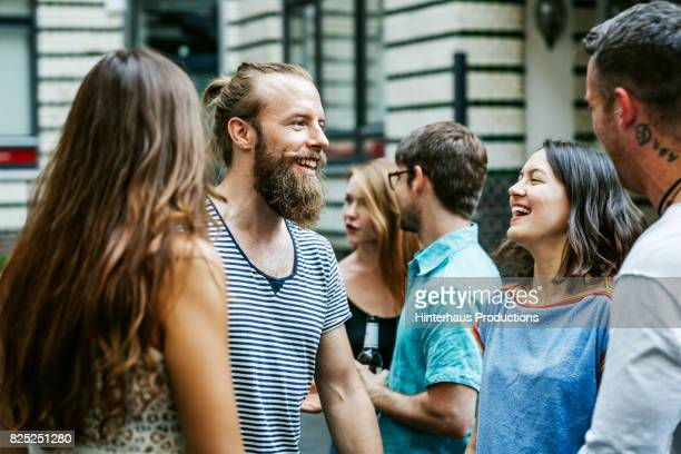a group of friends meeting together at barbecue - eenheid stockfoto's en -beelden