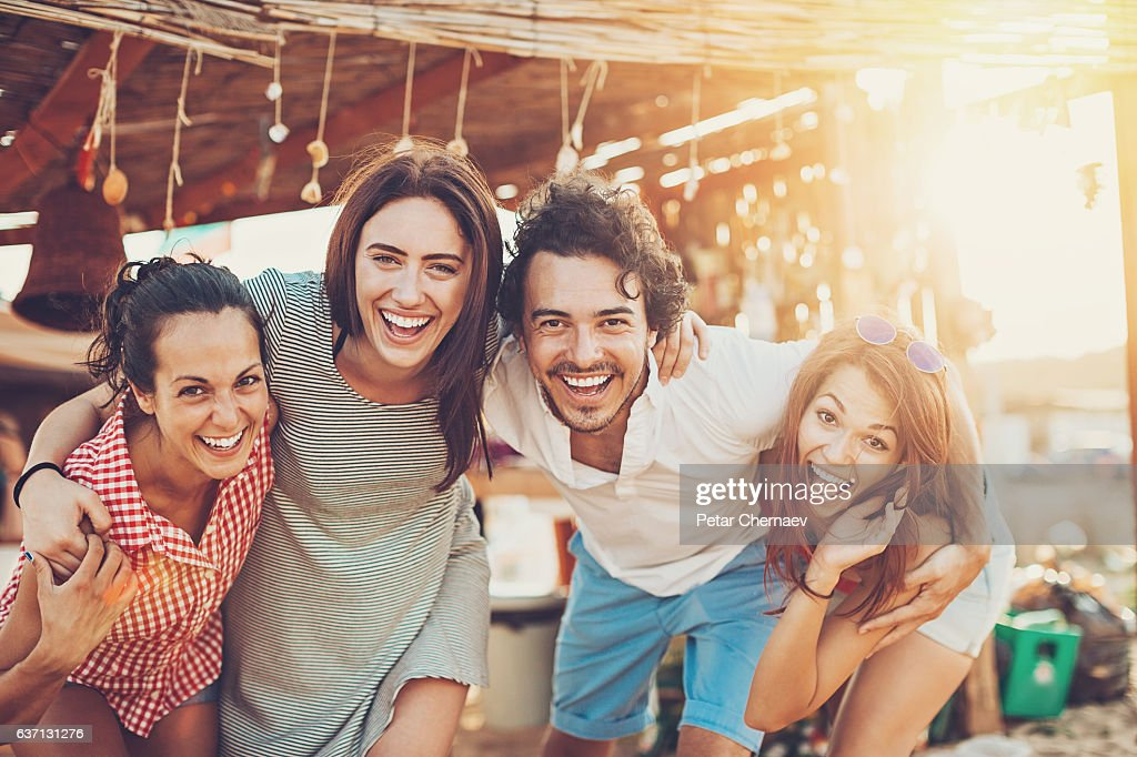 Group of friends on a beach camp : Stock Photo