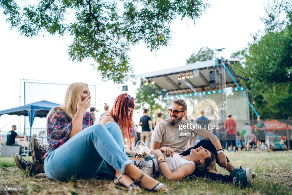 Group of friends on a music festival : Stock Photo