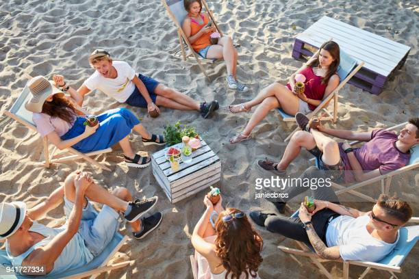 Group of friends on a picnic. Urban beach