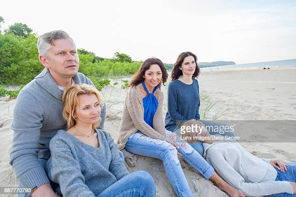 Group of friends on beach relaxing