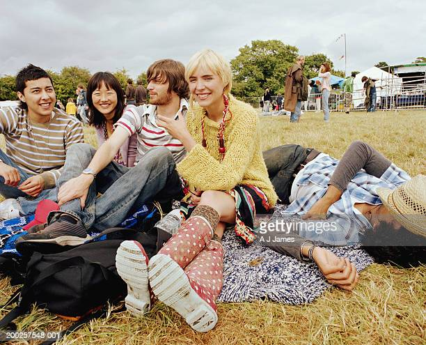 Group of friends on grass, smiling