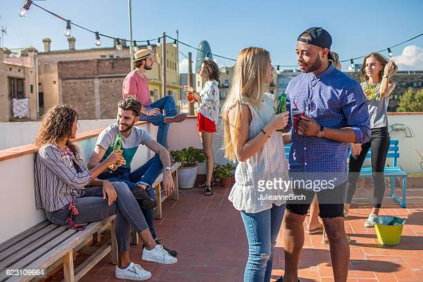Group of friends on rooftop terrace